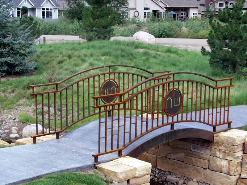 Charles Seha Professional Landscape Designer in Rochester, Minnesota -  Stone and Wood Bridge design for Homes and Businesses